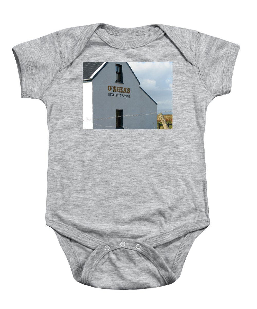Pub Baby Onesie featuring the photograph O'shea's by Kelly Mezzapelle