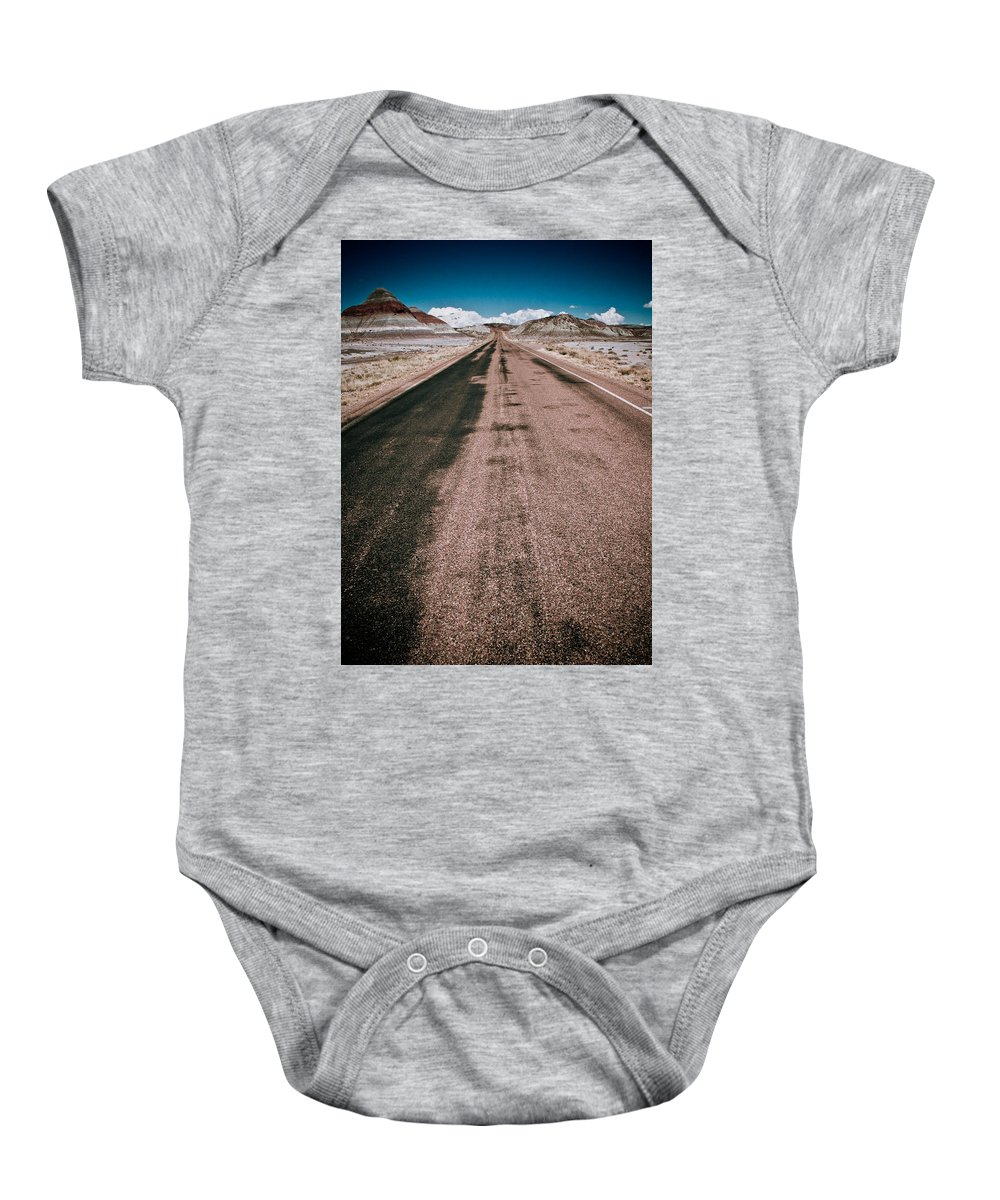 Painted Baby Onesie featuring the photograph Painted Desert Road #4 by Robert J Caputo
