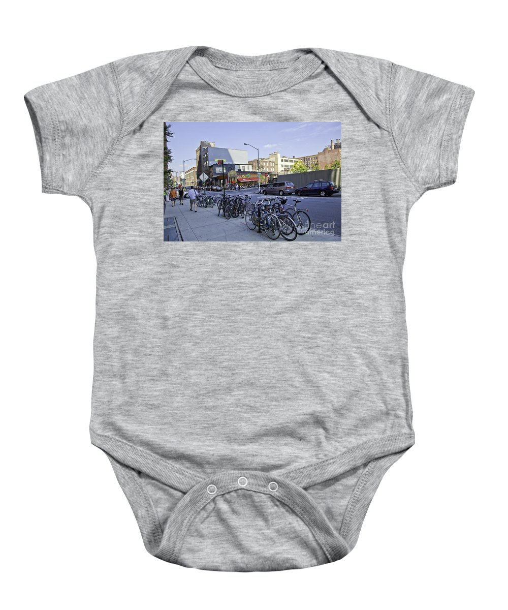 Dumbo Baby Onesie featuring the photograph Parked Bikes In Dumbo by Madeline Ellis
