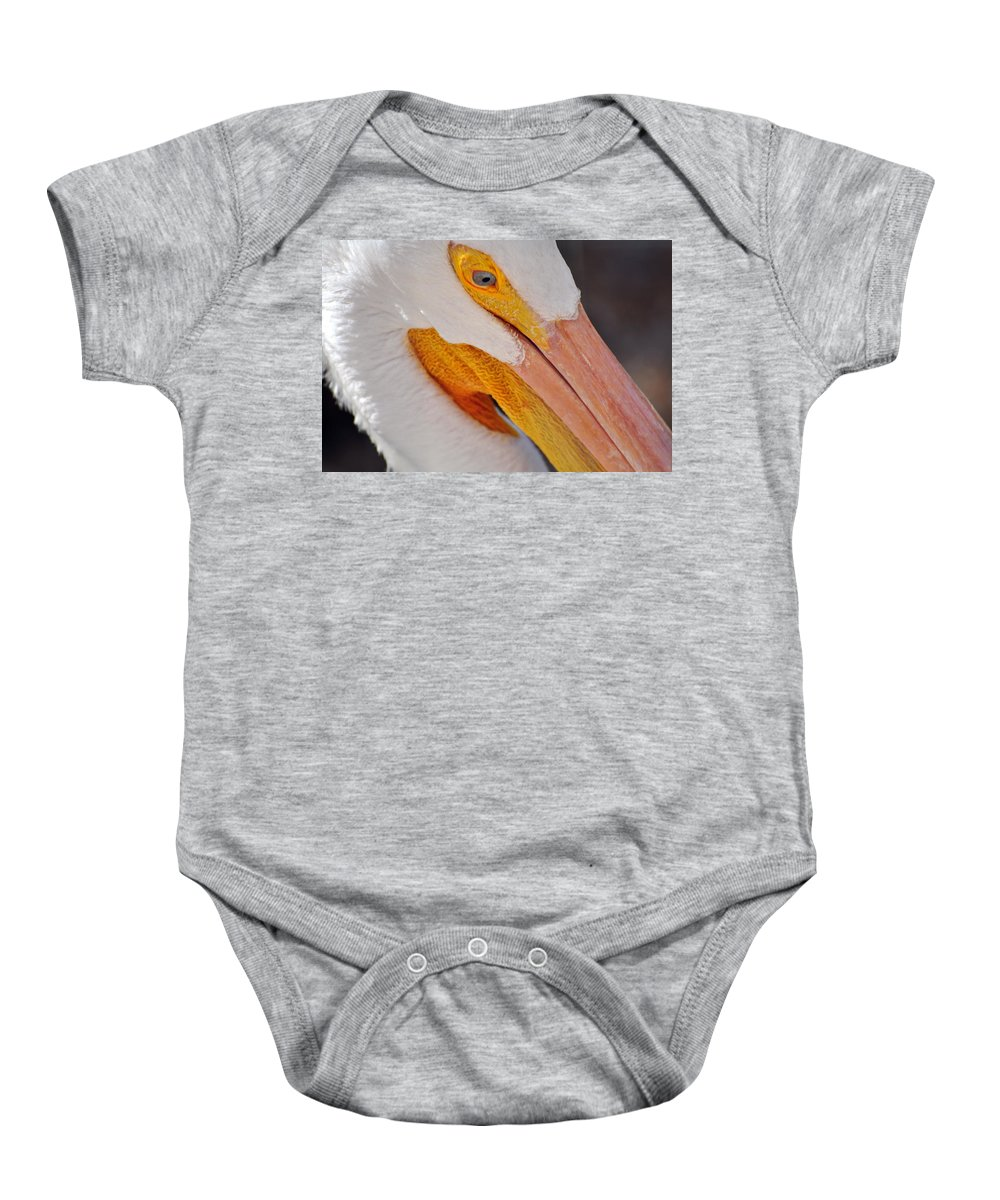 White Pelican Baby Onesie featuring the photograph Pelican Twist by Marty Koch