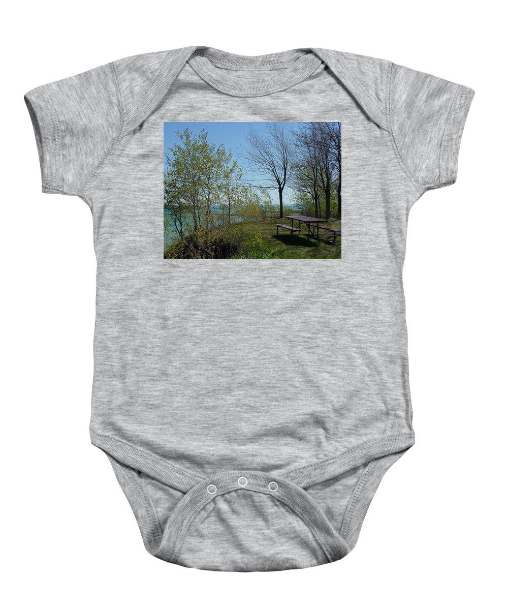 Lake View Baby Onesie featuring the photograph Picnic Table By The Lake Photo by Anita Burgermeister