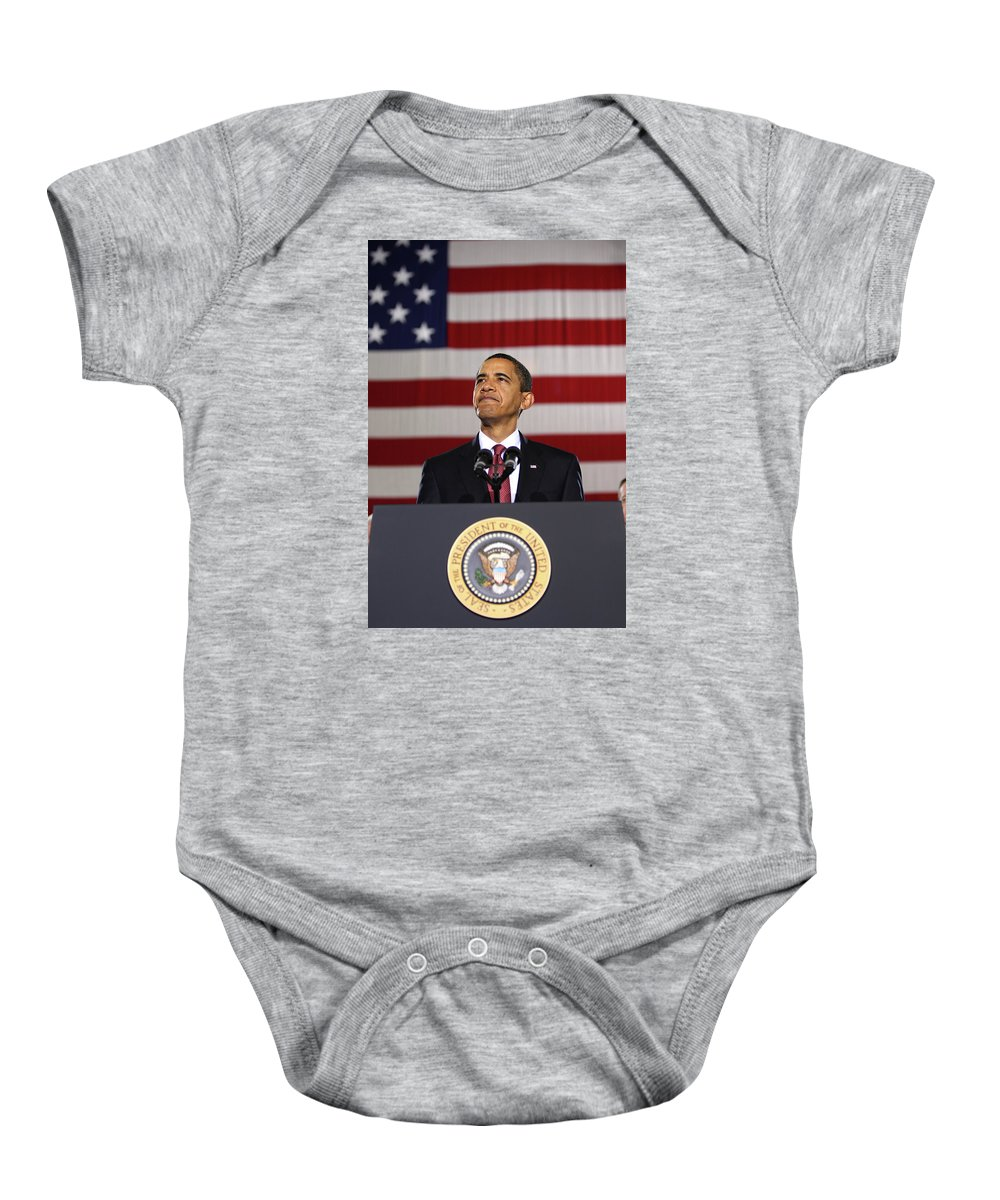 Obama Baby Onesie featuring the photograph President Obama by War Is Hell Store