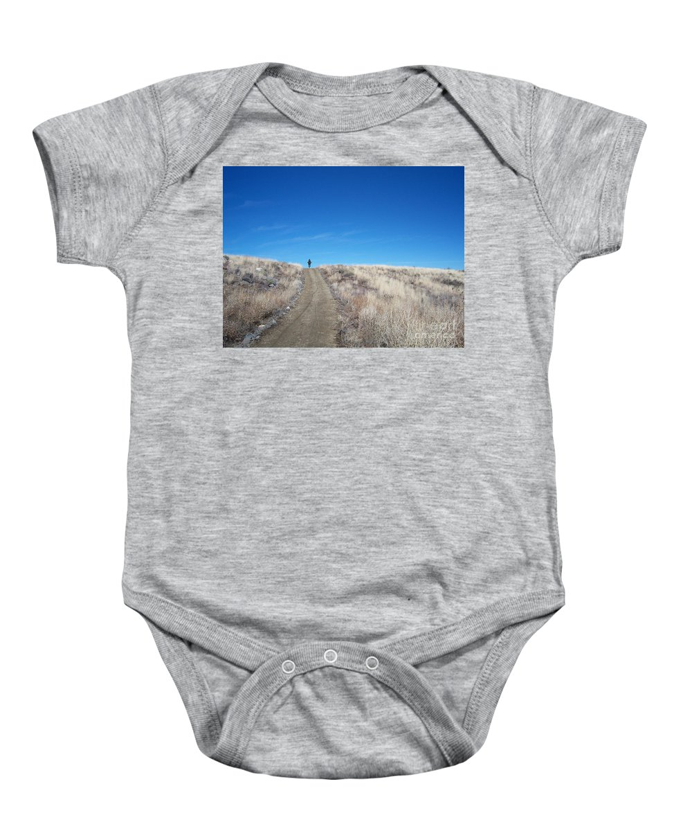 Racing Bike Baby Onesie featuring the photograph Racing Over The Horizon by Heather Kirk