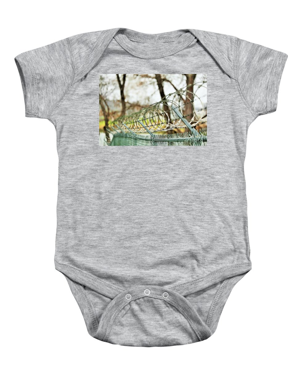 Baby Onesie featuring the photograph Razor by Jeff Downs