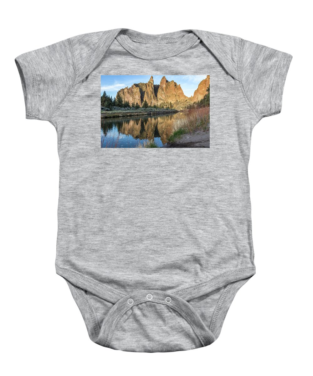 Smith Rock Baby Onesie featuring the photograph Reflection Of Smith Rock In Crooked River by Belinda Greb