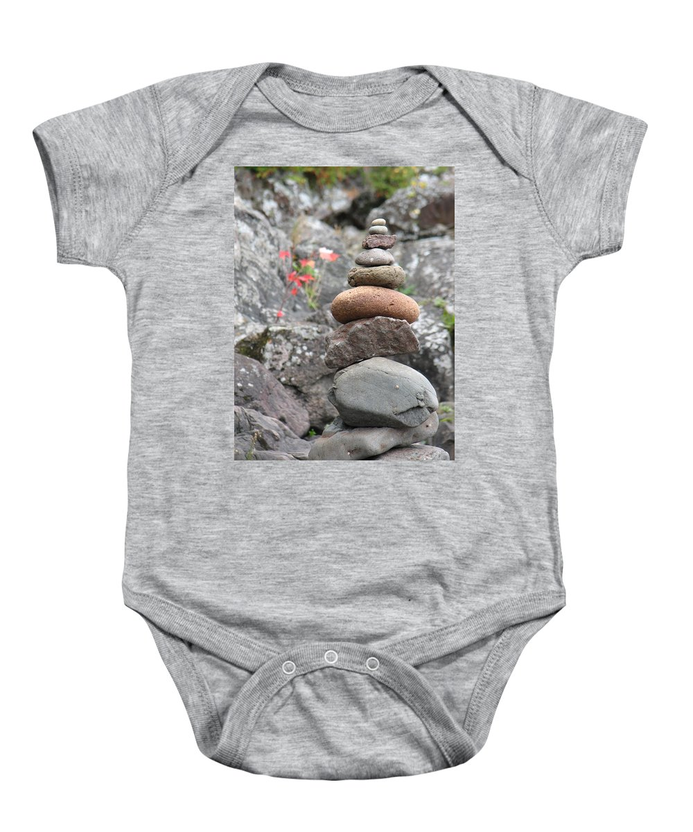 Rocks Baby Onesie featuring the photograph Rocks And Roses by Kelly Mezzapelle