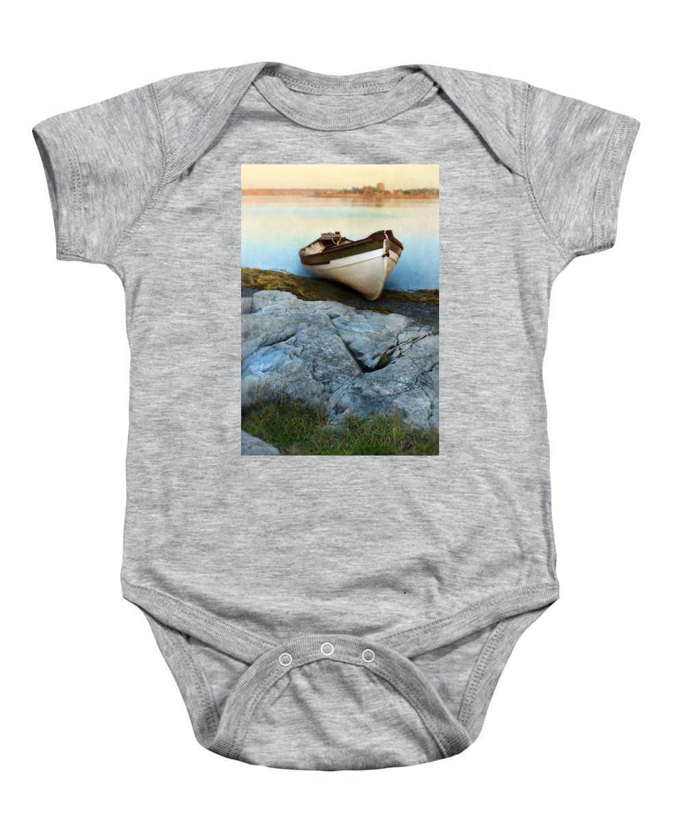 Coast Baby Onesie featuring the photograph Row Boat On Shore by Jill Battaglia