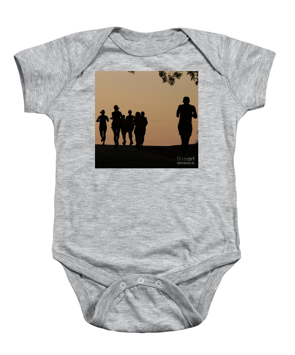 Running Baby Onesie featuring the photograph Running by Angela Wright
