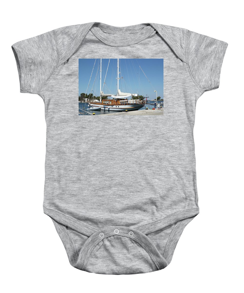 Ship Baby Onesie featuring the photograph Sailboat In Harbor Summer Vacation Scene by Goce Risteski