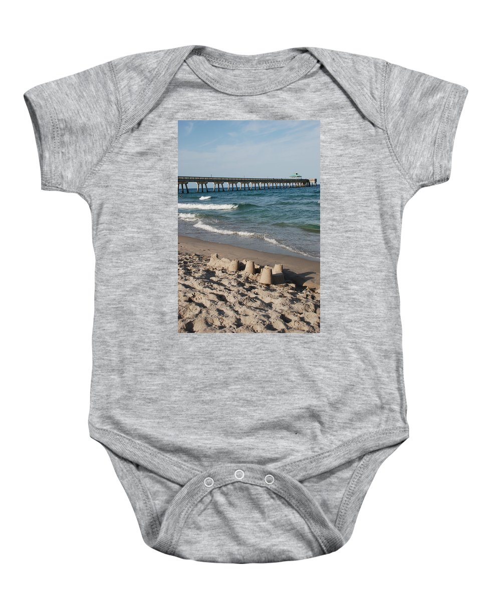 Sea Scape Baby Onesie featuring the photograph Sand Castles And Piers by Rob Hans
