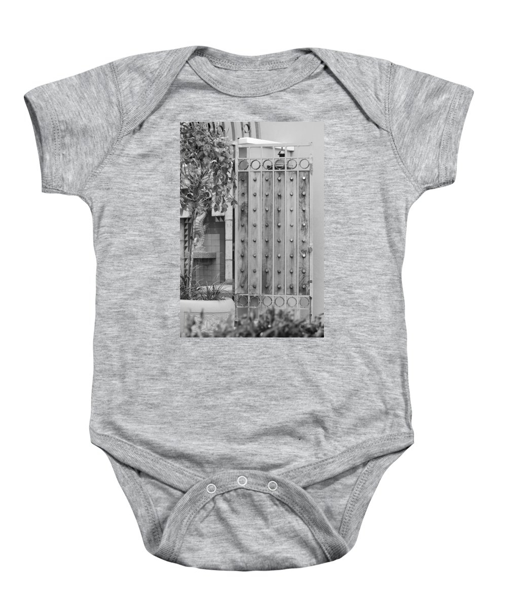 Black And White Baby Onesie featuring the photograph Sea Horse Gate by Rob Hans