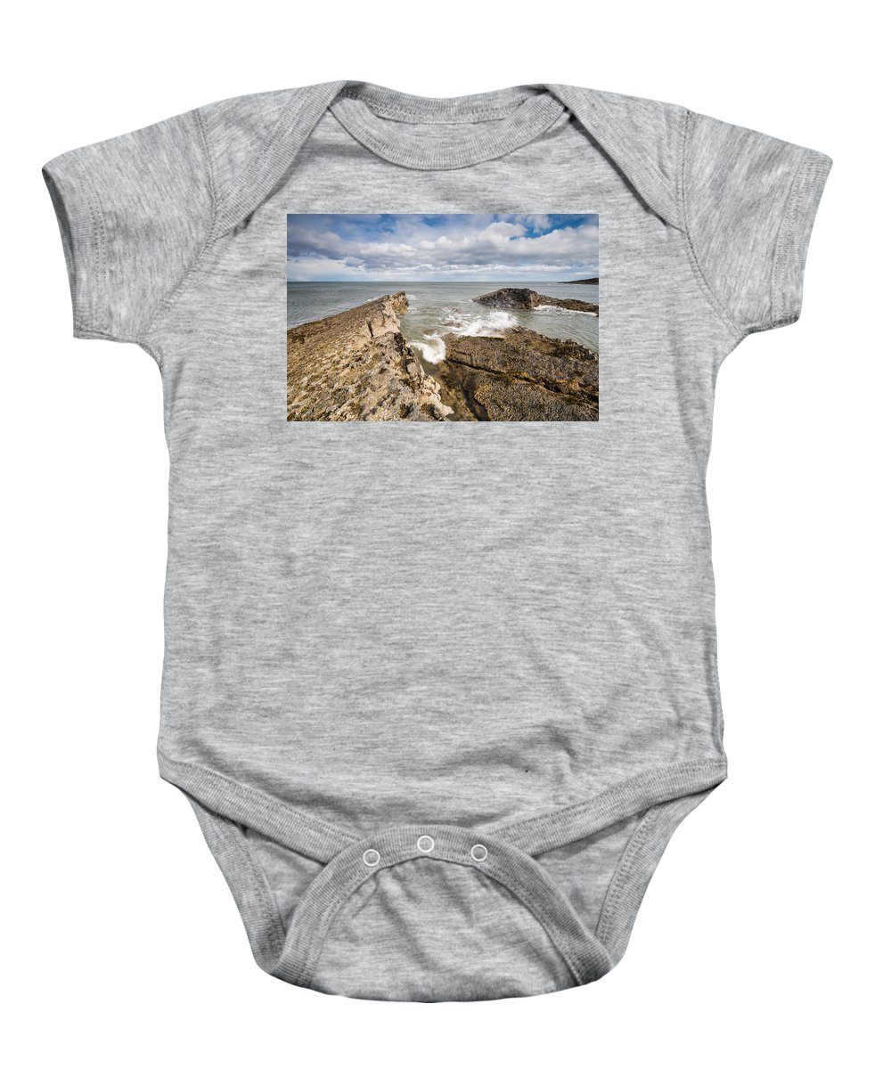 Northumberland Baby Onesie featuring the photograph Sea Meets Rocks At Howick by David Head