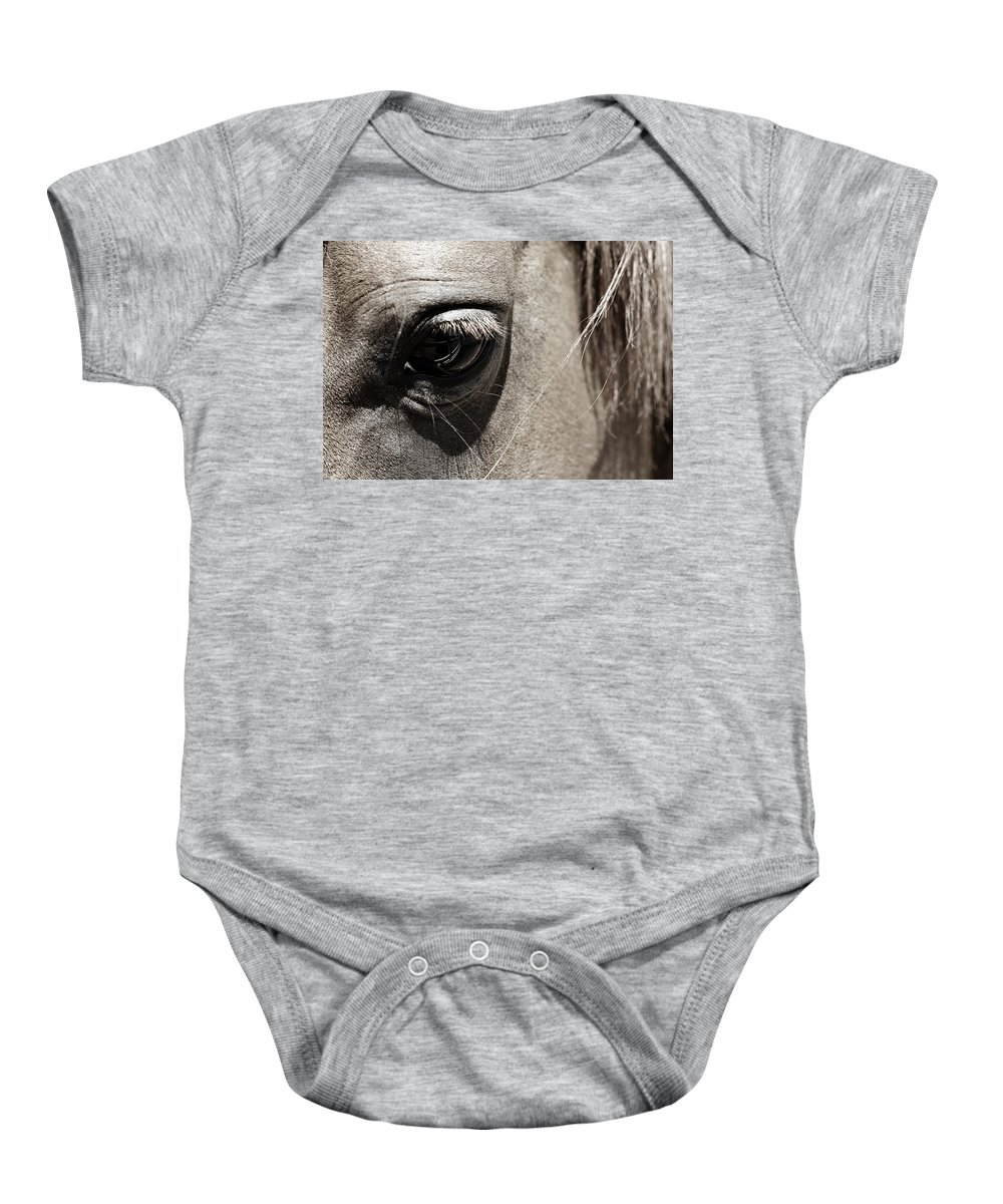 Americana Baby Onesie featuring the photograph Stillness In The Eye Of A Horse by Marilyn Hunt