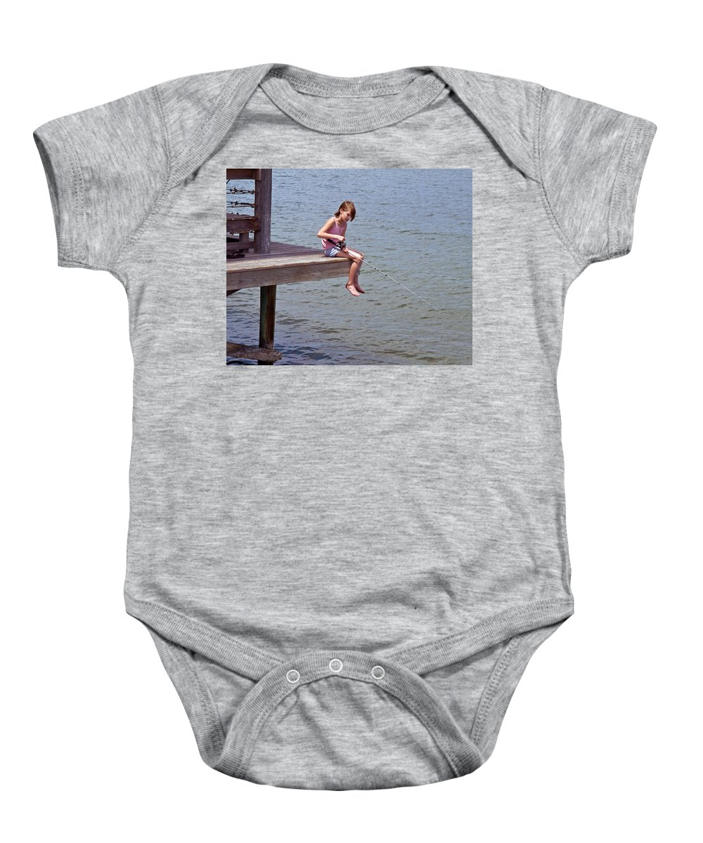 Fish; Fishing; Fisherman; Fisherwoman; Fishergirl; Girl; Florida; Brevard; Indian; River; Space; Coa Baby Onesie featuring the photograph Serious Fishergirl On The Indian River In Florida by Allan Hughes