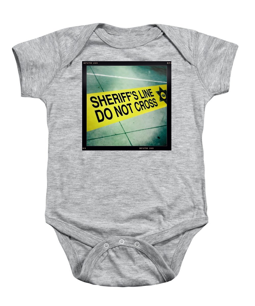 Sheriff's Line Baby Onesie featuring the photograph Sheriff's Line - Do Not Cross by Nina Prommer