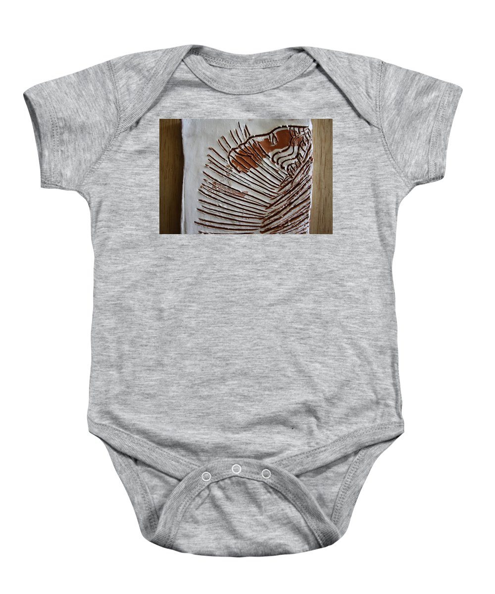 Jesus Baby Onesie featuring the ceramic art Simeon - Tile by Gloria Ssali