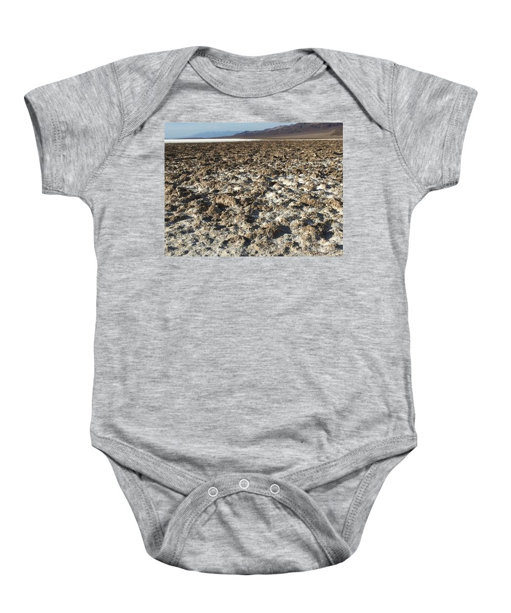 Salt Baby Onesie featuring the photograph Sin Agua by David Gallagher