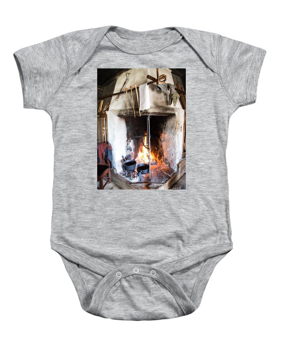 Skansen Baby Onesie featuring the photograph Skansen Fire by Suzanne Luft