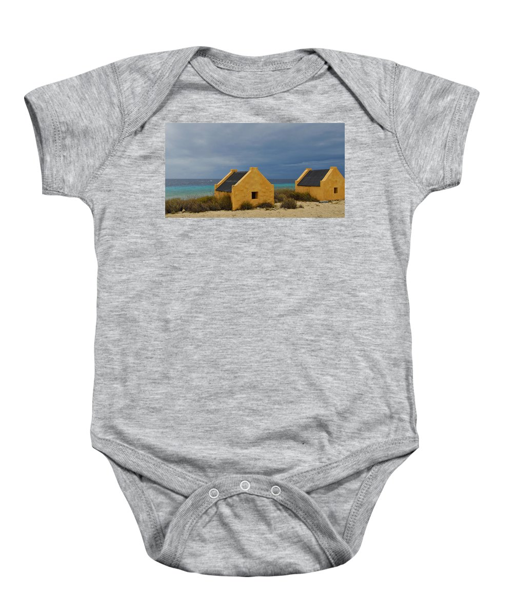 Slave Baby Onesie featuring the photograph Slave Huts by Stephen Anderson