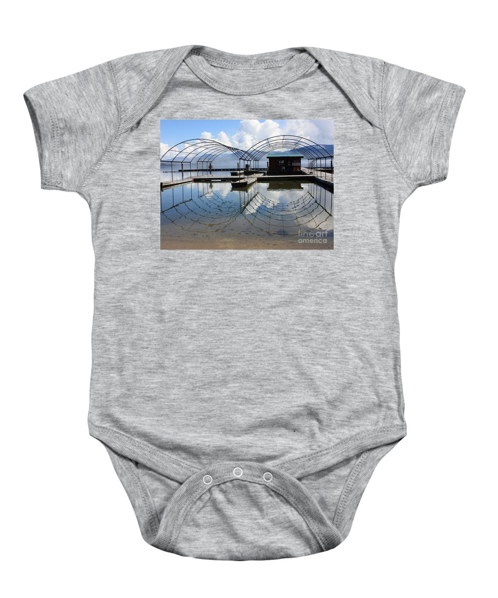 Spring Baby Onesie featuring the photograph Spring Docks On Priest Lake by Carol Groenen