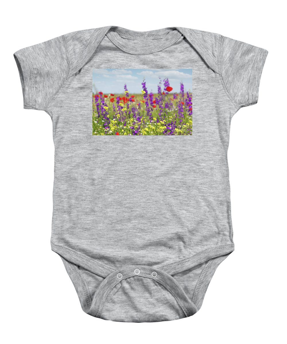 Camomile Baby Onesie featuring the photograph Spring Meadow With Flowers Nature Scene by Goce Risteski
