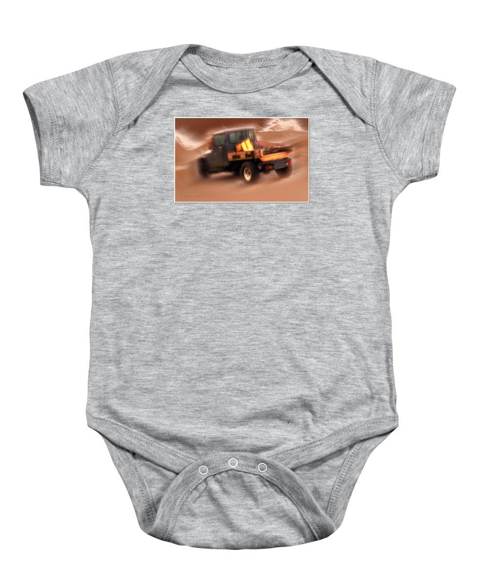 Storm Baby Onesie featuring the photograph Still Truckin' by Gerry Tetz