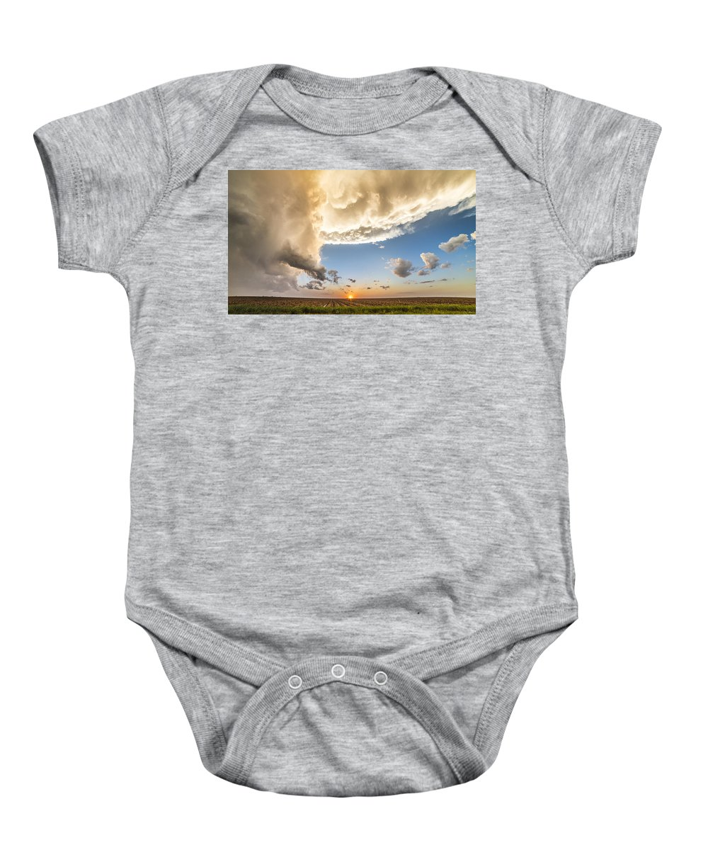 Storm Baby Onesie featuring the photograph Stormy Sunset by Brandon Sullivan
