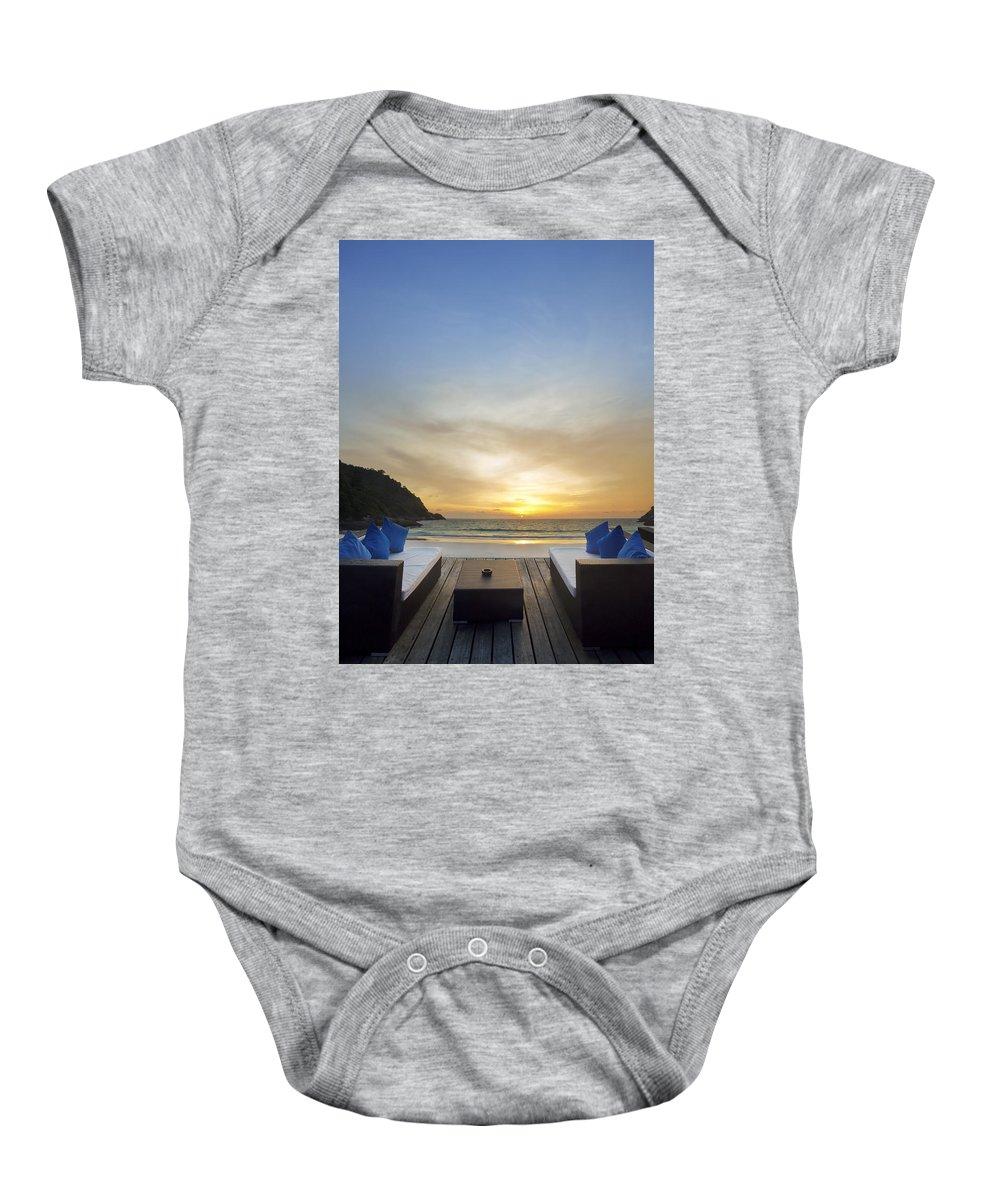 Andaman Baby Onesie featuring the photograph Sunset Beach by Setsiri Silapasuwanchai