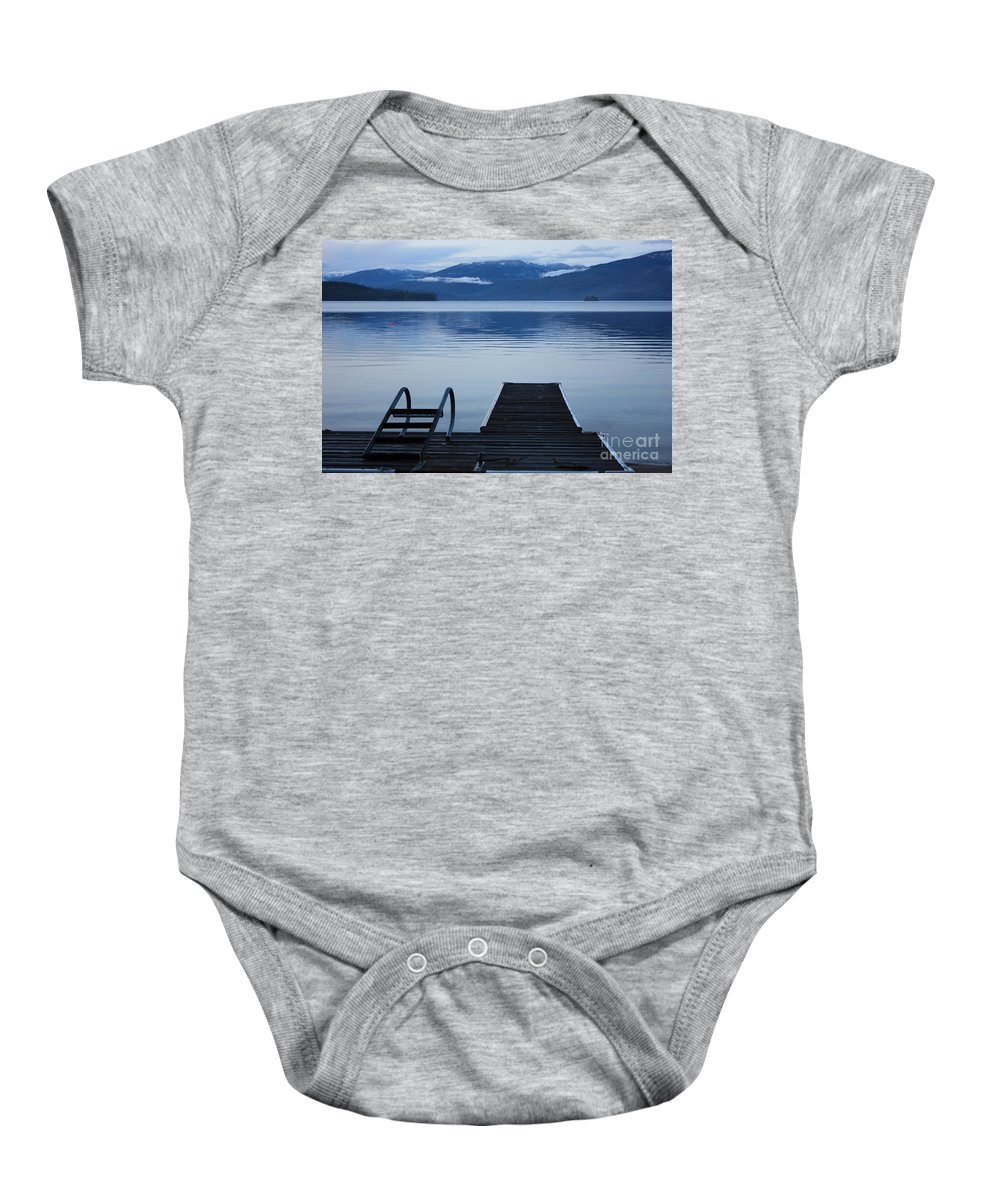 Priest Lake Baby Onesie featuring the photograph Sunset Dock At Priest Lake by Carol Groenen