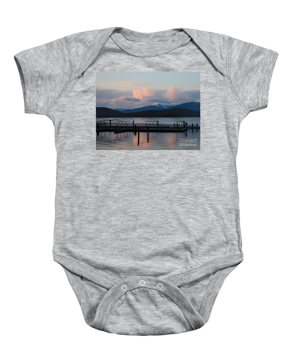 Priest Lake Baby Onesie featuring the photograph Sunset Reflecting Off Priest Lake by Carol Groenen
