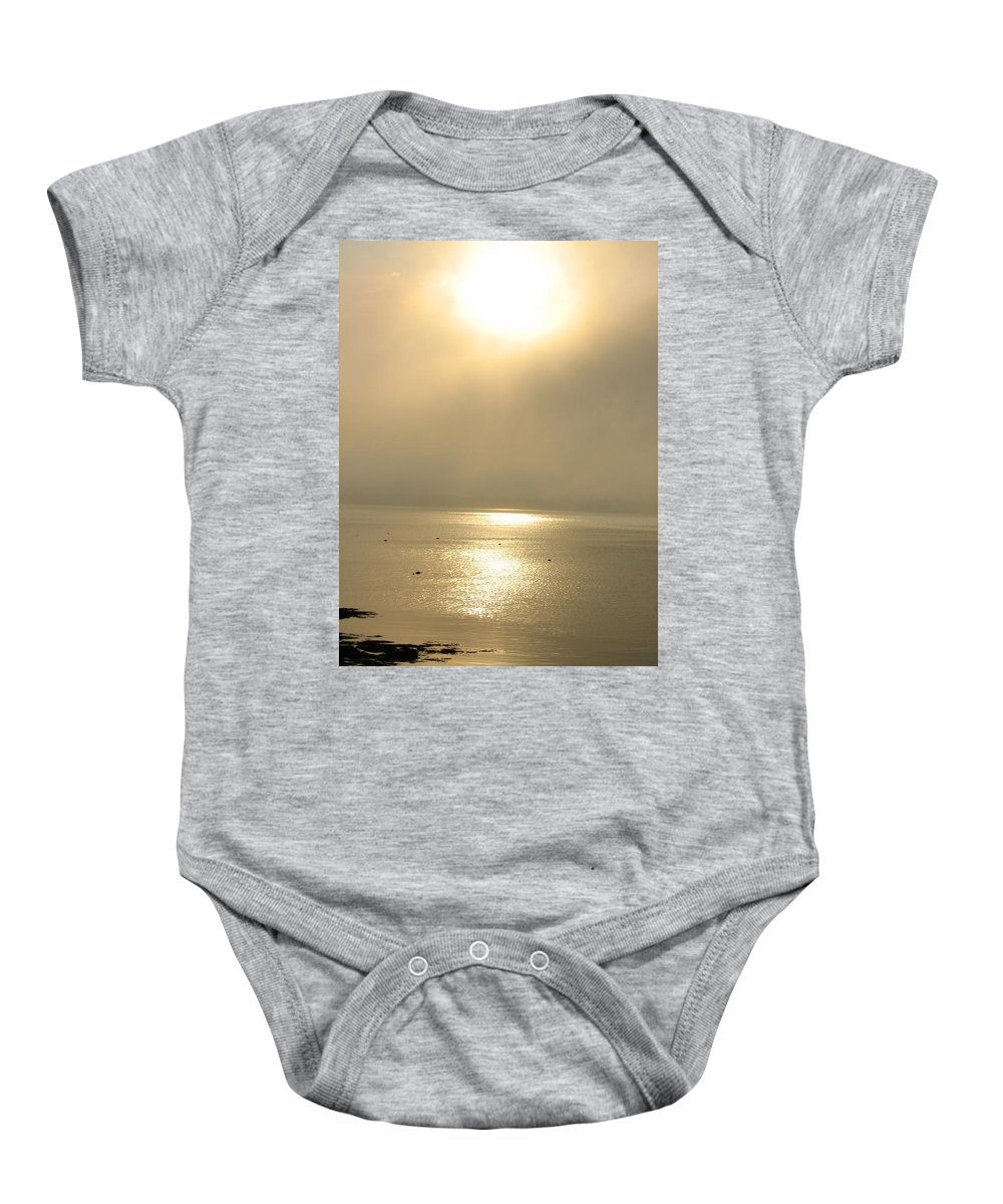 Sun Baby Onesie featuring the photograph Sunset Through Fog by Kelly Mezzapelle