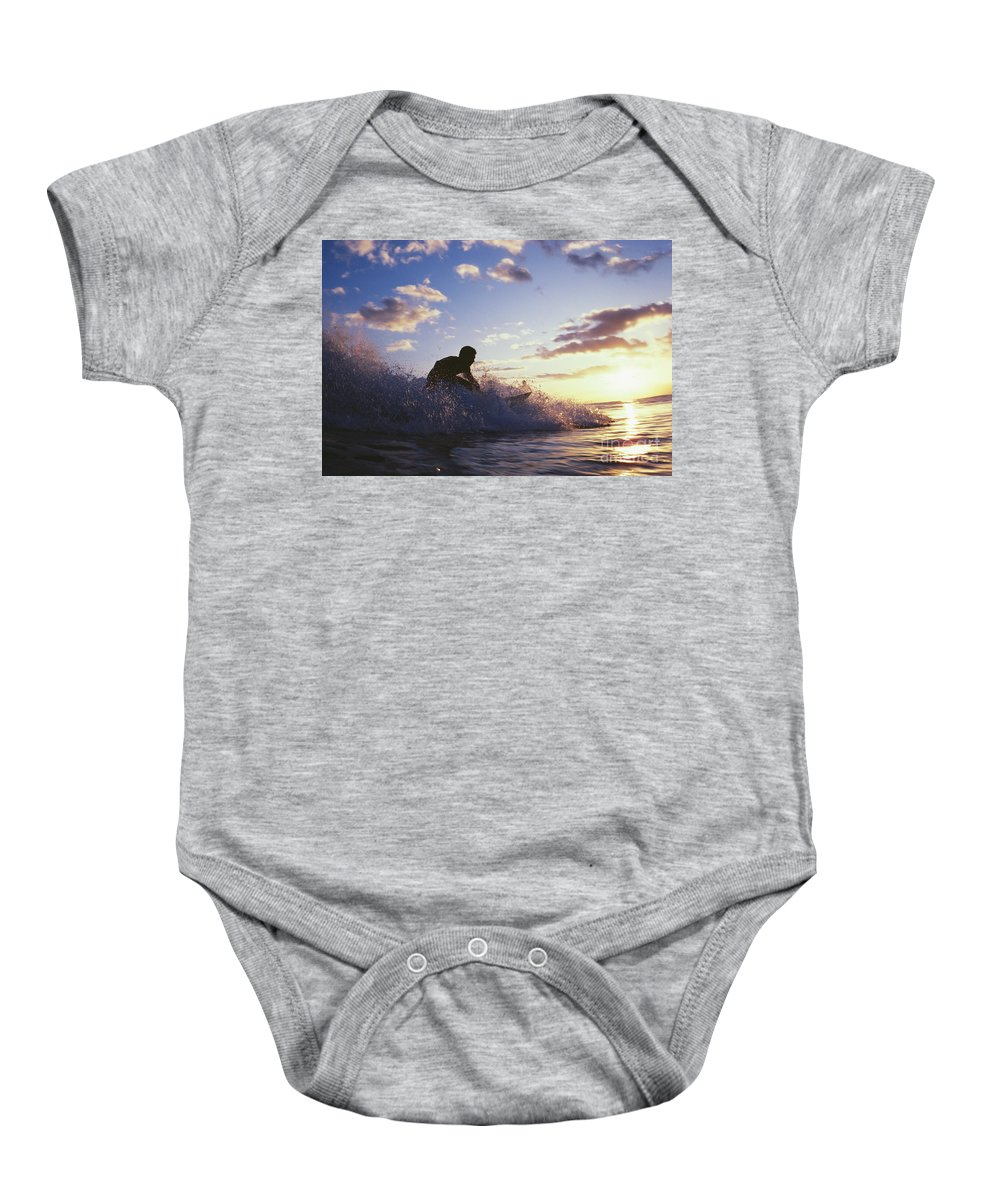 Adrenaline Baby Onesie featuring the photograph Surfer At Sunset by Bob Abraham - Printscapes