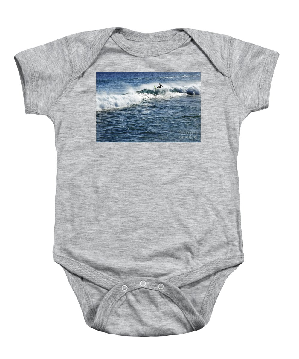 Adrenaline Baby Onesie featuring the photograph Surfer Riding A Wave by Brandon Tabiolo - Printscapes