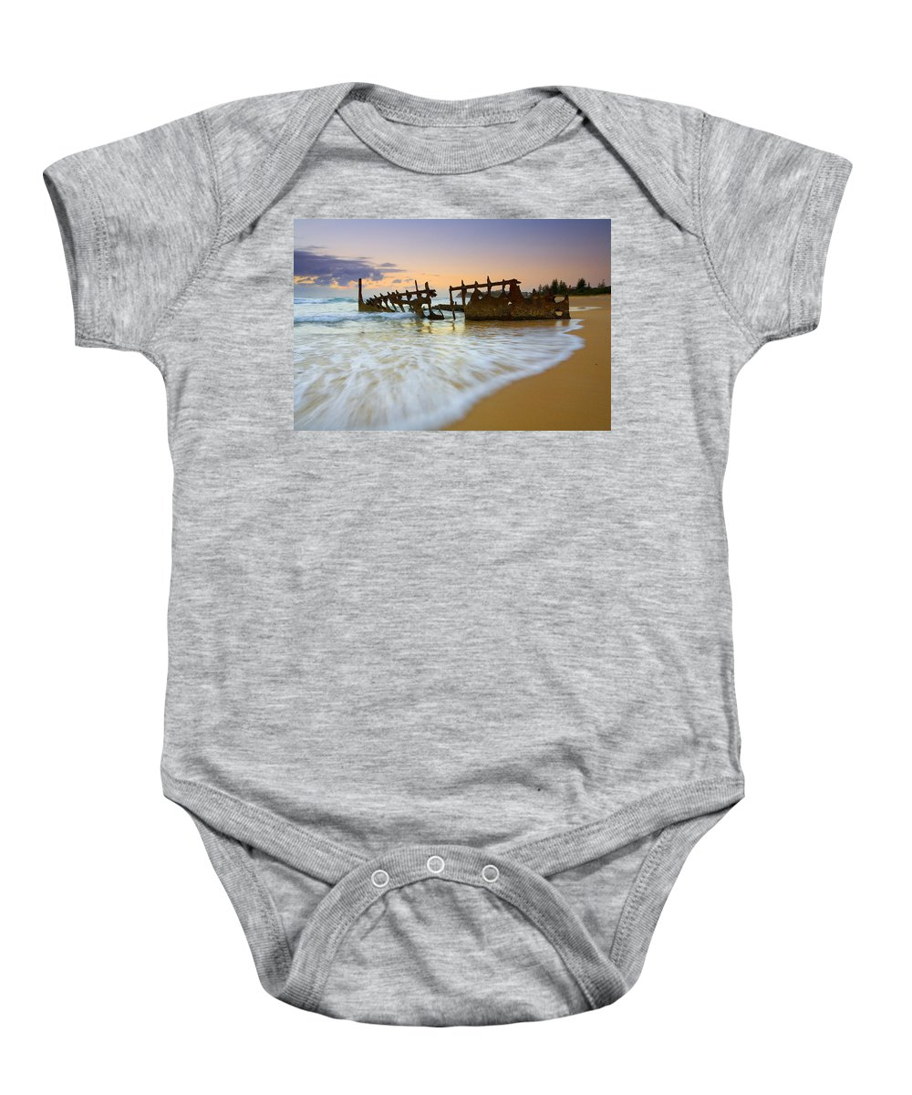 Shipwreck Baby Onesie featuring the photograph Swallowed By The Tides by Mike Dawson