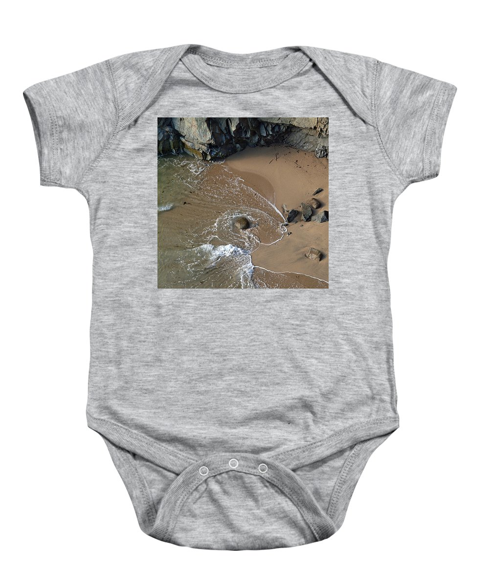 Big Sur Baby Onesie featuring the photograph Swirling Surf And Rocks by Charlene Mitchell