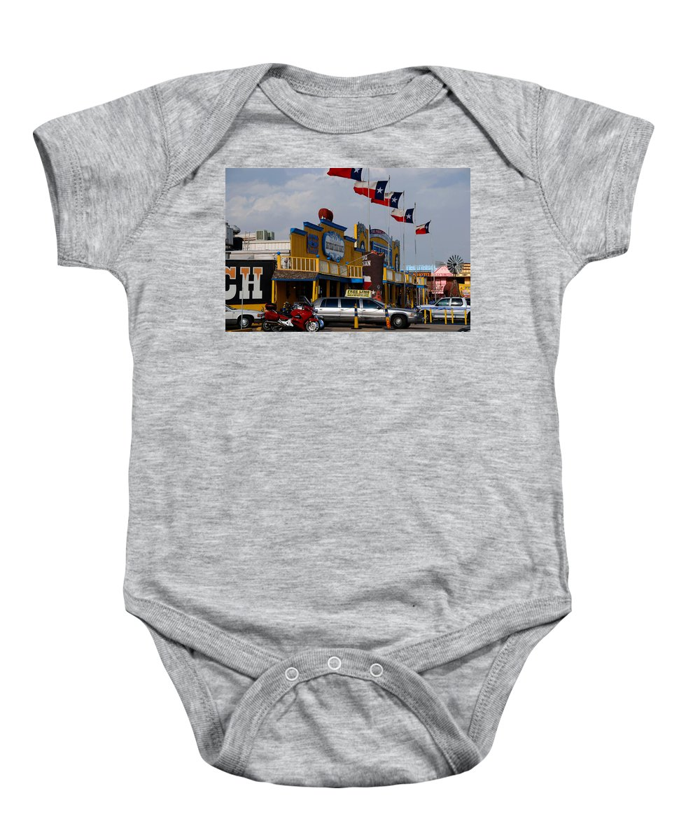 The Big Texan Baby Onesie featuring the photograph The Big Texan In Amarillo by Susanne Van Hulst