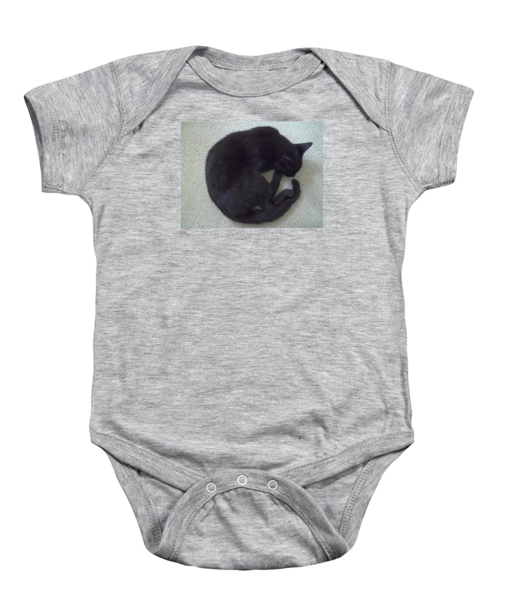 Black Cat Baby Onesie featuring the photograph The Curled Black Cat by Aaron Crooks