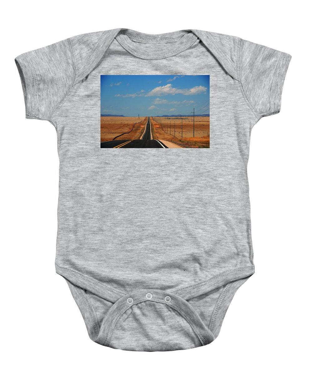 Long Road Baby Onesie featuring the photograph The Long Road To Santa Fe by Susanne Van Hulst