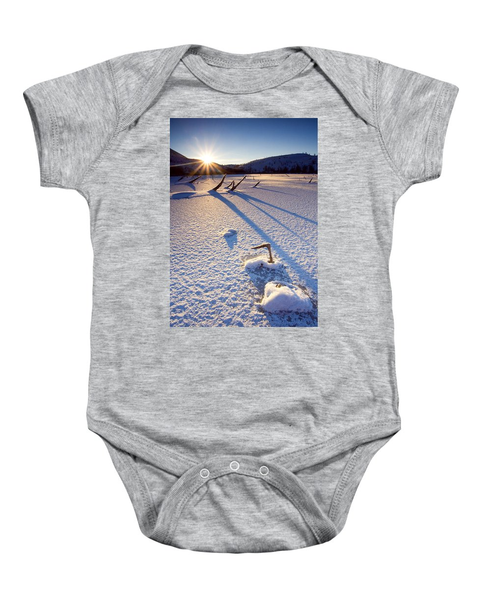 Sunrise Baby Onesie featuring the photograph The Long Shadows Of Winter by Mike Dawson