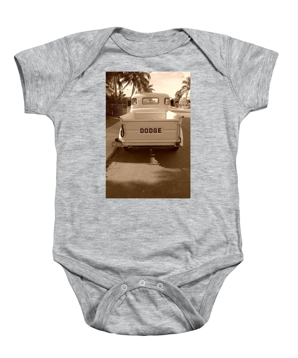 Sepia Baby Onesie featuring the photograph The Old Dodge by Rob Hans