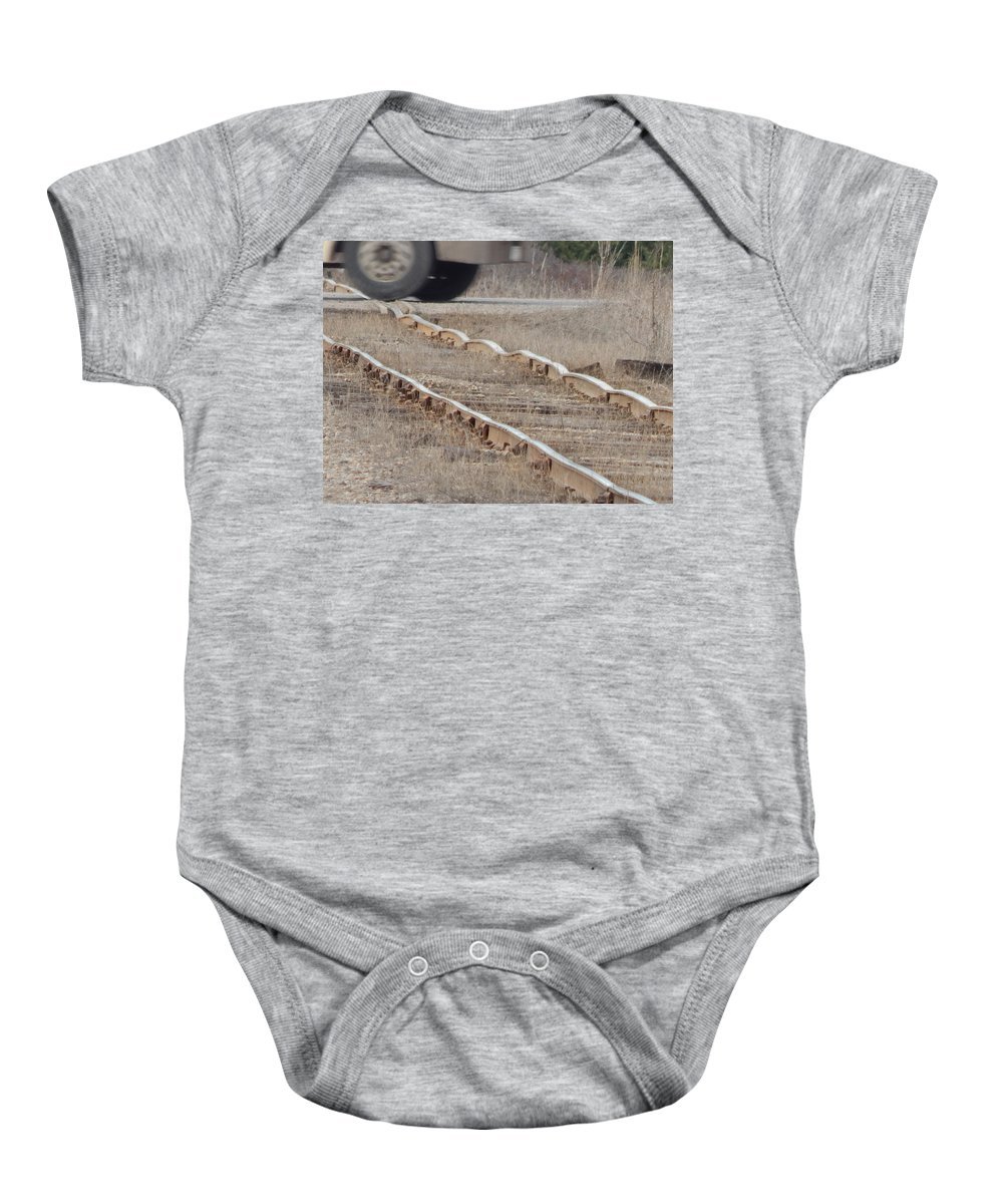 Train Baby Onesie featuring the photograph The Warped Railroad by Jason Asselin