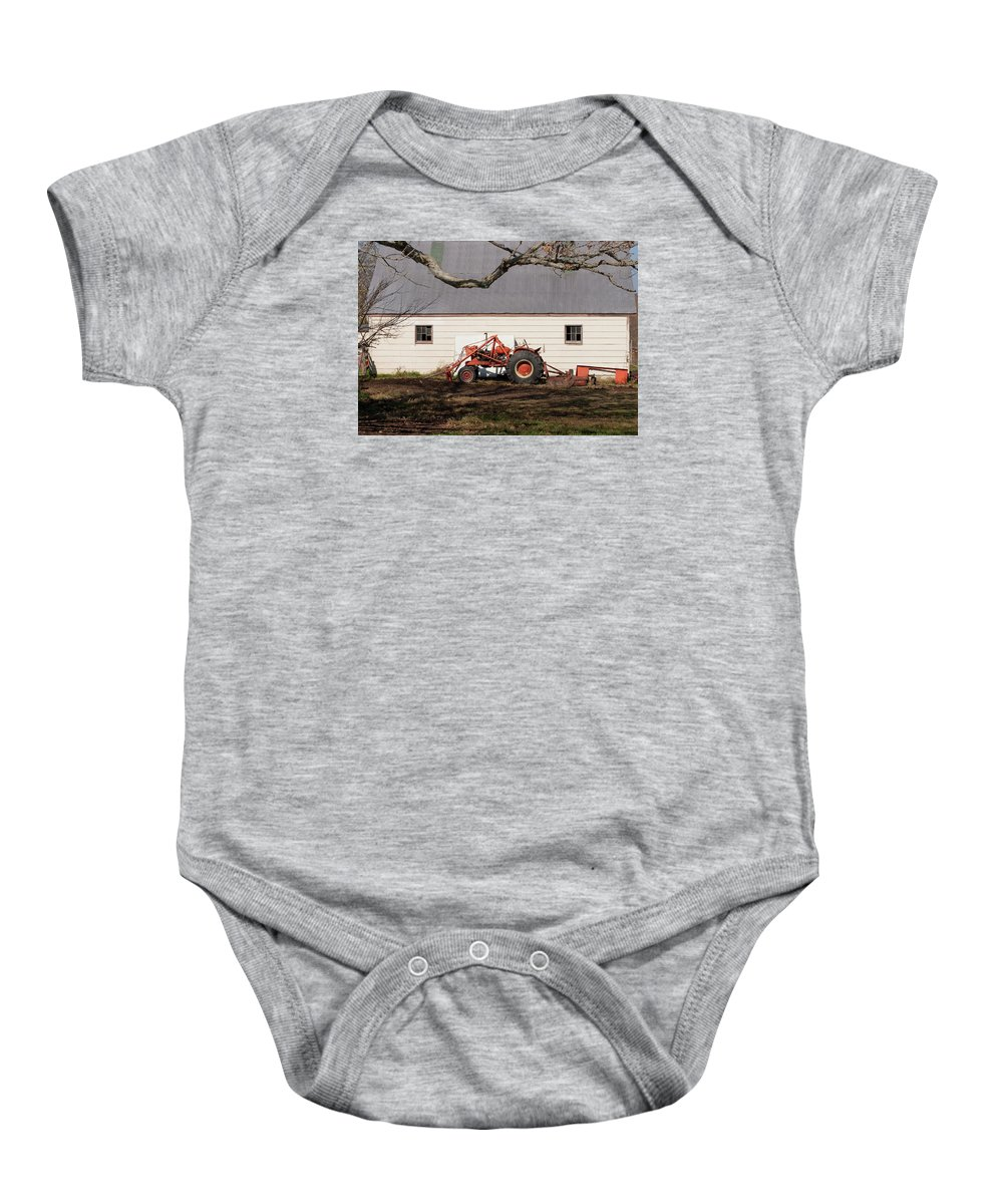 Tractor Baby Onesie featuring the photograph Tractor Barn Branch by Grant Groberg