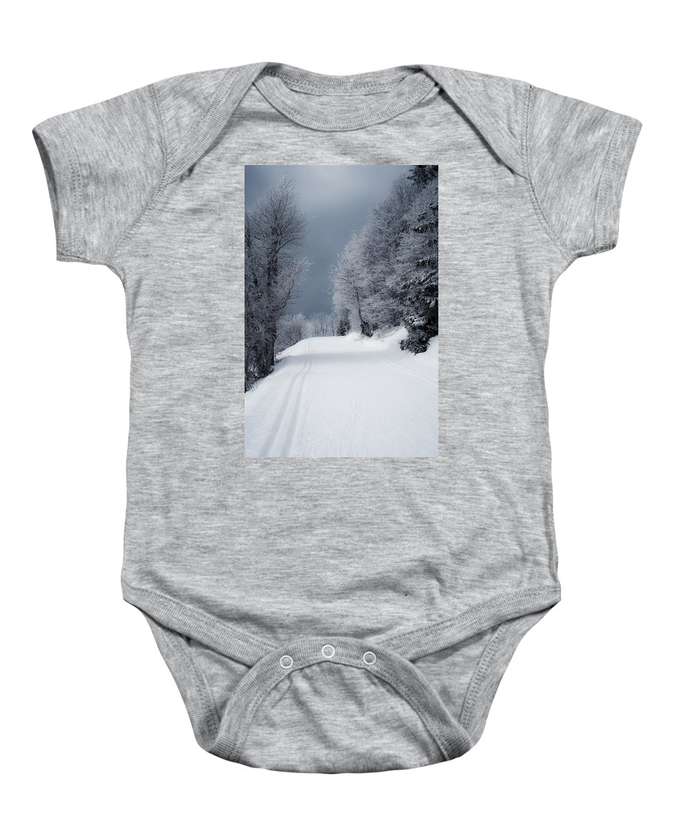 Miguel Baby Onesie featuring the photograph Trees Hills And Snow by Miguel Winterpacht