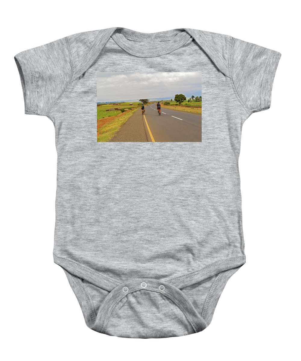 Man Baby Onesie featuring the photograph Two Men Riding Bicycle In Tanzania by Marek Poplawski