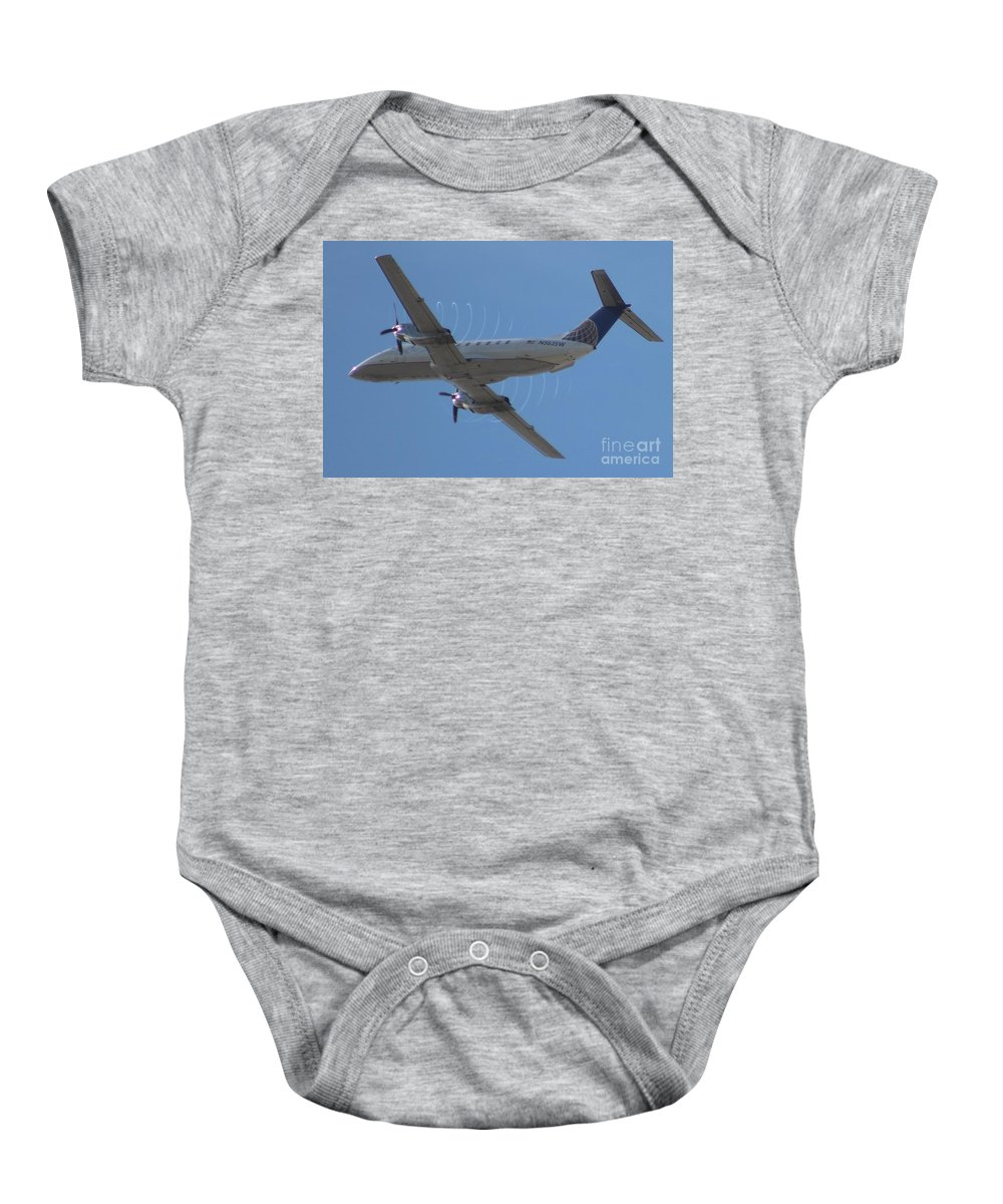 United Airlines Baby Onesie featuring the photograph United Metroliner by John Linder