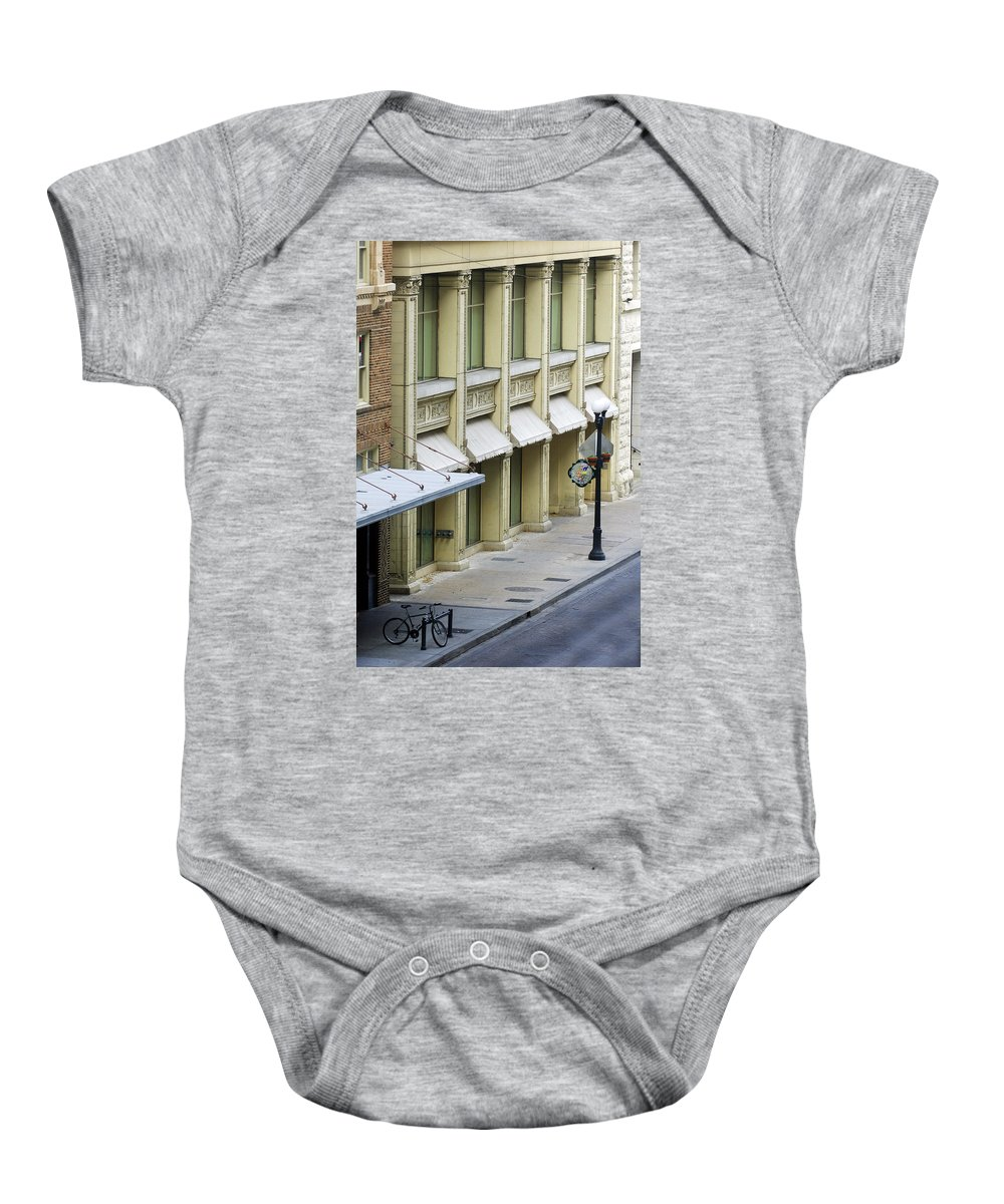 Street Scene Baby Onesie featuring the photograph Uno Cycle by Jill Reger