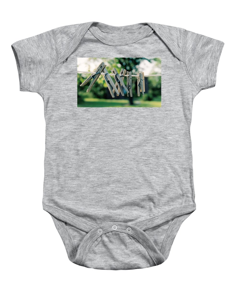 Clothes Pins Baby Onesie featuring the photograph Waiting For Work by Lauri Novak