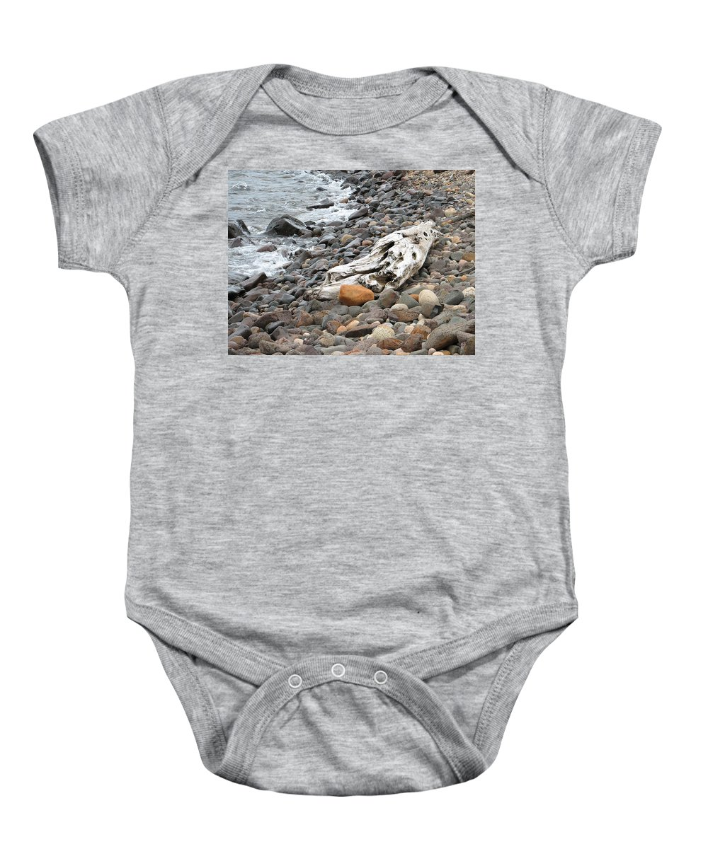 Driftwood Baby Onesie featuring the photograph Washed Up by Kelly Mezzapelle