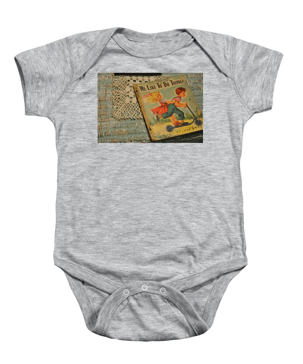 Still Life Baby Onesie featuring the photograph We Like To Do Things by Jan Amiss Photography