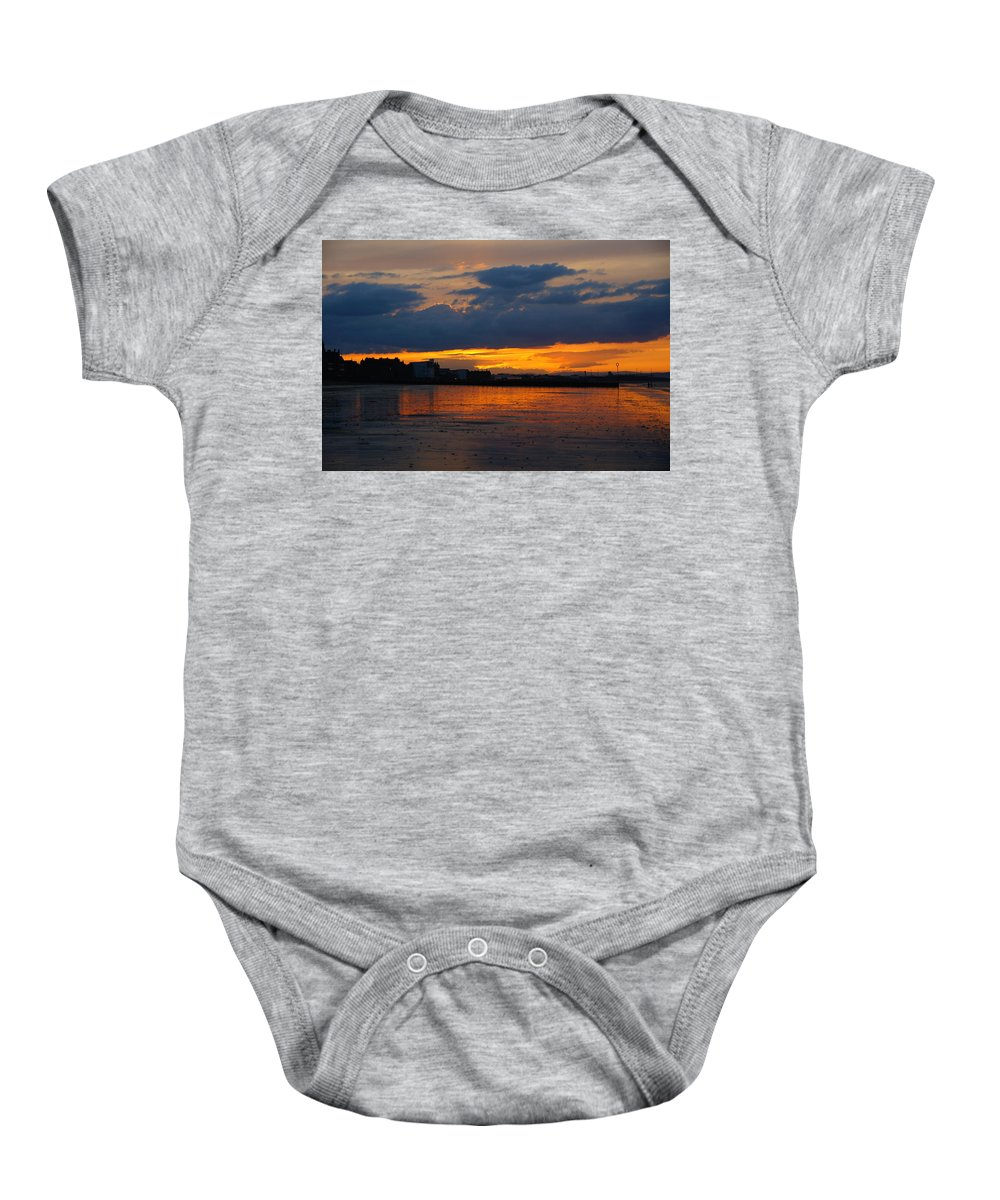 Nik Watt Baby Onesie featuring the photograph Wet Sand And Clouds by Nik Watt
